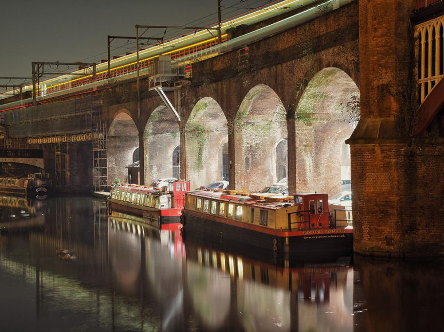 Photograph of Canal Boat under a Viaduct at Castlefields Canal Basin in Manchester - taken on a Welshot Photographic Academy Evening Learn Your Camera